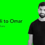 picture of a bearded man wearing a black t-shiort on a green background