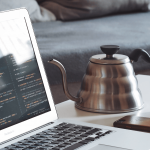 picture of a MacBook Air next to a teapot