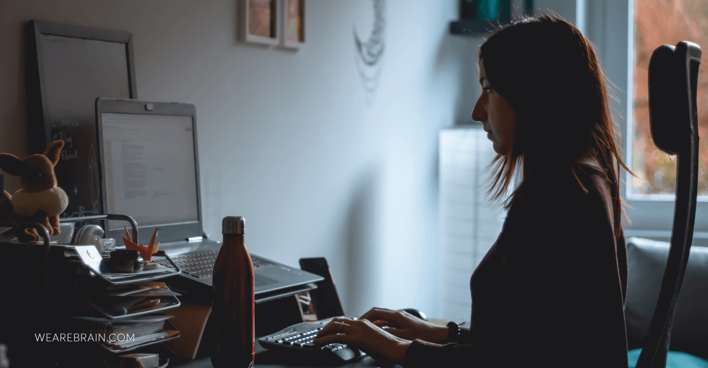 picture of a woman typing on a laptop