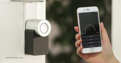 a phone unlocking a smart home lock
